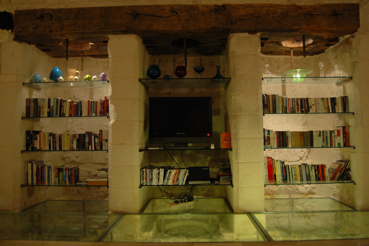 OLive press with TV and book shelves
